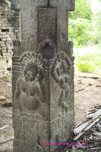 interior pillar of eclipse pavilion at Mahabalipuram with reliefs, dancer and unknown figure